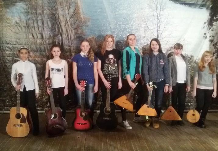 Коллективное обучение игре на гитаре